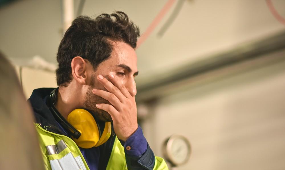 worker with a headache